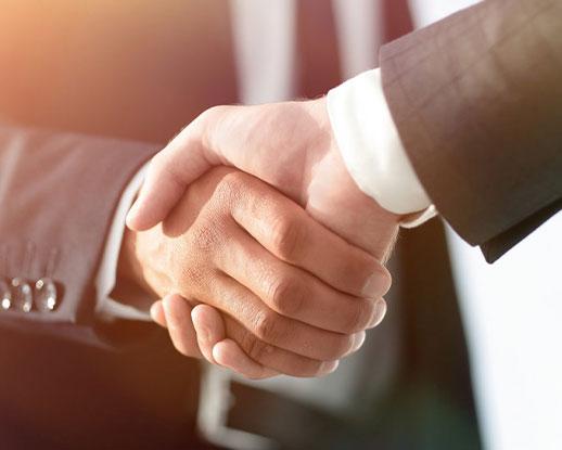 Business men giving a handshake