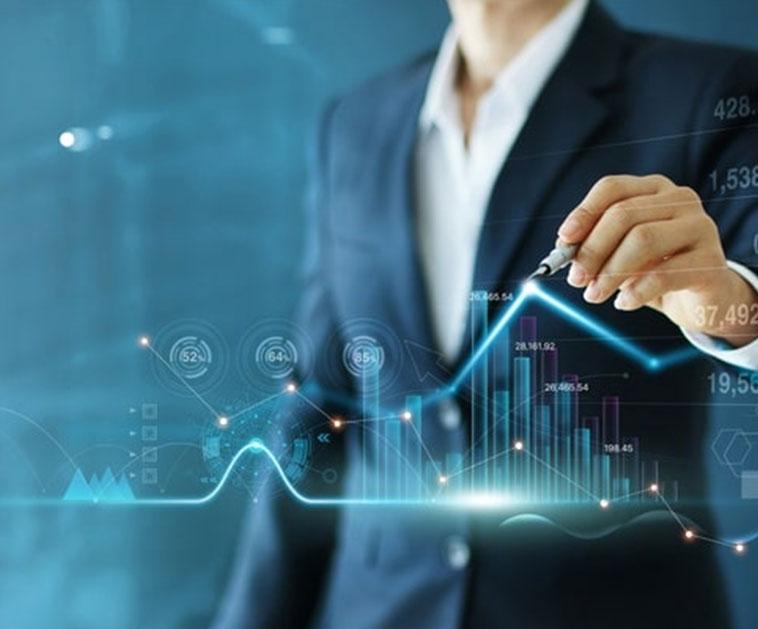A businessman drawing market infographs on screen